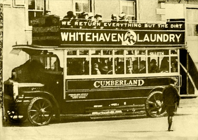 Open topped bus, Whitehaven to Silloth, advertising Whitehaven Laundry, about 1920